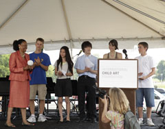 ICAF Youth Board Members presenting the World Children's Award 2011 to the W. K. Kellogg Foundation at the opening of the 4th WorldChildren's Festival on the National Mall, Washington DC on June 17, 2011.